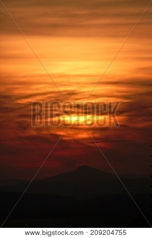 Dramatic sunset over the distant hills