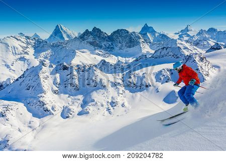 Skiing with amazing view of swiss famous mountains in beautiful winter snow  Mt Fort. The matterhorn and the Dent d'Herens. In the foreground the Grand Desert glacier.