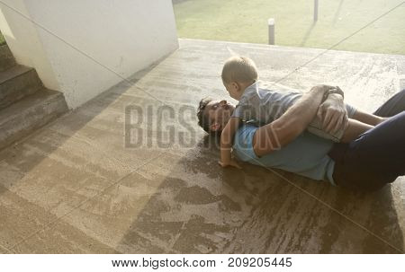 Caring father hugging his son