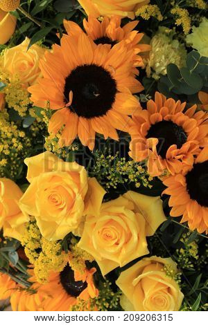 Mixed flower arrangement: various flowers in different shades of yellow for a wedding
