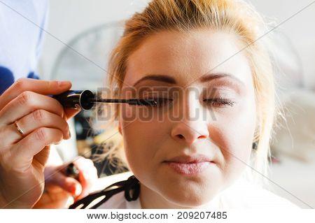 Woman Getting Eyelashes Makeup Done