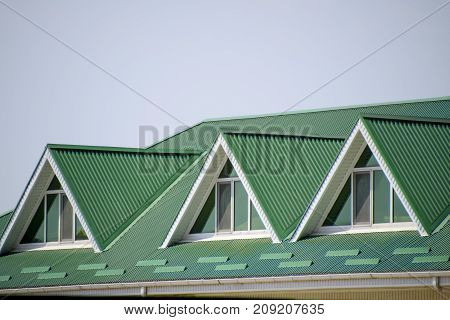 The House With Plastic Windows And A Green Roof Of Corrugated Sh