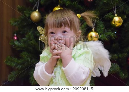 One Year Old Baby Girl Sitting On The Background Of The Christma