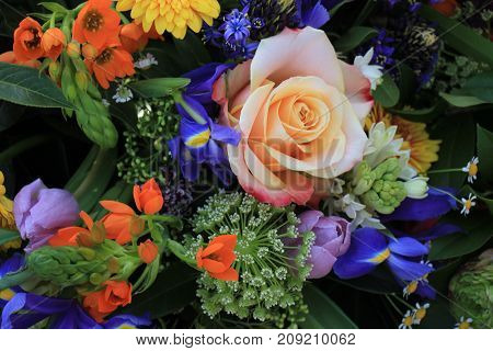 Mixed flower arrangement: various flowers in different colors for a wedding