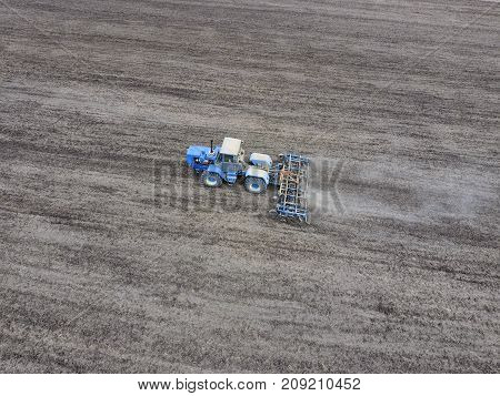 Cultivation Of Soil For The Sowing Of Cereals. Tractor Plows The