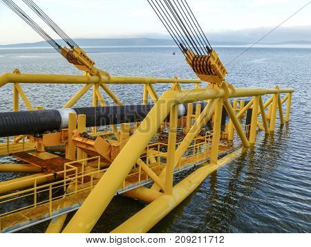 Laying Of Pipes With Pipe-laying Barge Crane Near The Shore. Des
