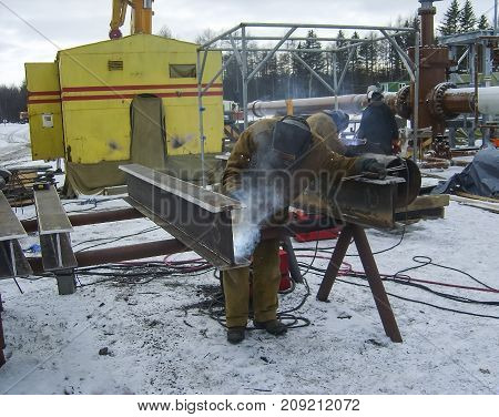 Safety At Work. Welding And Grinding Of Iron Constructions. Indu