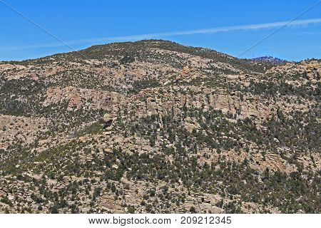 View from Windy Point on Mount Lemmon in Tucson, Arizona, USA in the Santa Catalina Mountains located in the Coronado National Forest with blue sky copy space.