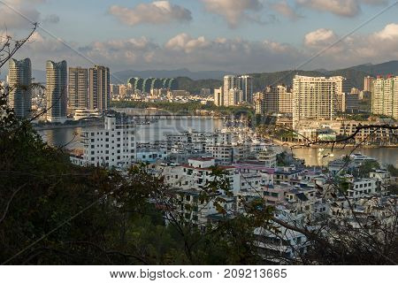 Sanya, China - April 07, 2017: Evening view of Sanya from the top of a hill in a Luhuitou Park