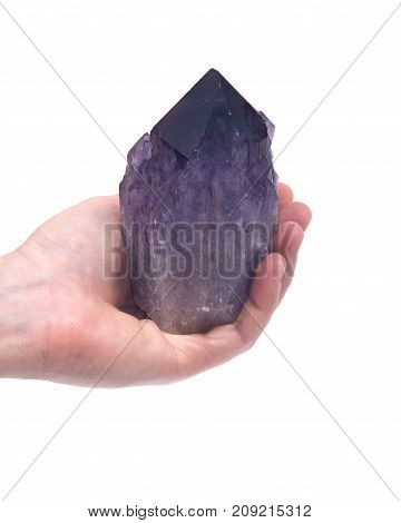 Woman's hand holding Ametrine lightbrary point from Bolivia isolated on white background