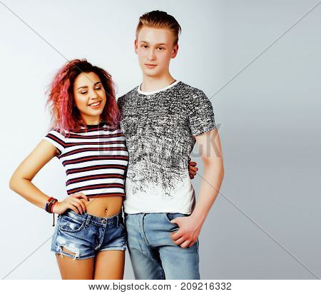 best friends teenage girl and boy together having fun, posing emotional on white background, couple happy smiling, lifestyle people concept, blond and brunette multi nations close up