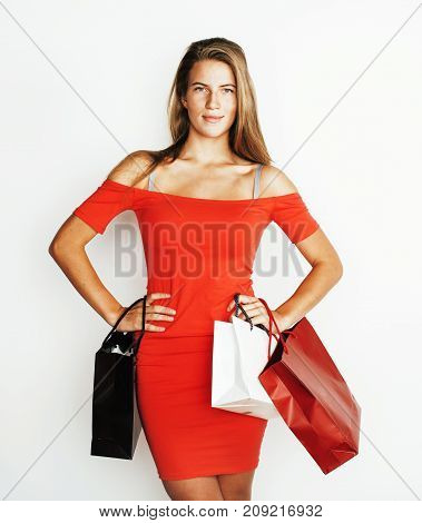 young modern blond woman with diverse bags  posing emotional on white background, sale, lifestyle people concept close up