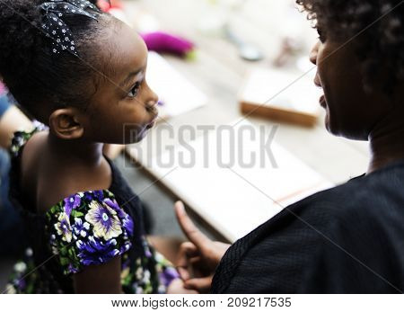 African descent girl is listening to her teacher