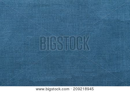Blue burlap background and texture The texture of the burlap closeup