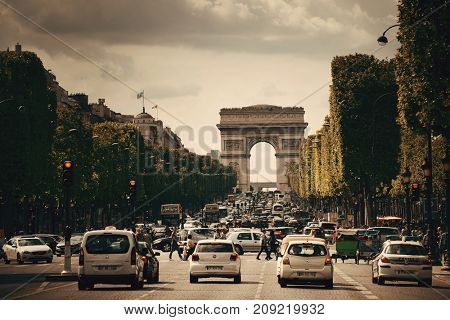 PARIS, FRANCE - MAY 13: street view and Arc de Triomphe on May 13, 2015 in Paris. With the population of 2M, Paris is the capital and most-populous city of France