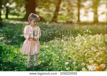 Portrait of beautiful little girl in park