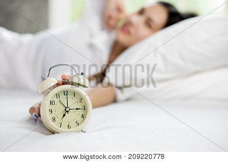 Asian Woman Happy Wake Up And Turning Off The Alarm Clock Having A Good Day