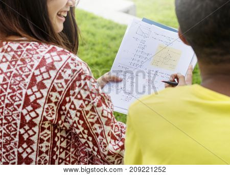 Students doing homework in the park