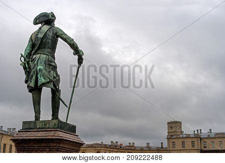 Gatchina Russia - September 30 2017: Monument to Russian Emperor Paul I in front of the Gatchina Palace. Rear view against a cloudy sky background.