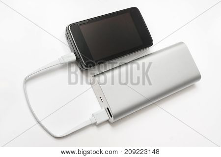 Charging smartphone from white power bank by USB cable