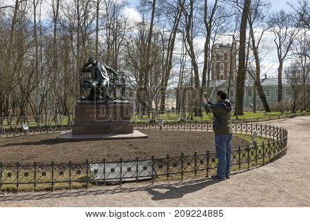 SAINT PETERSBURG, RUSSIA, MAY 07, 2017:The tourist photographs a monument to Alexander Sergeevich Pushkin in Tsarskoe Selo St. Petersburg.