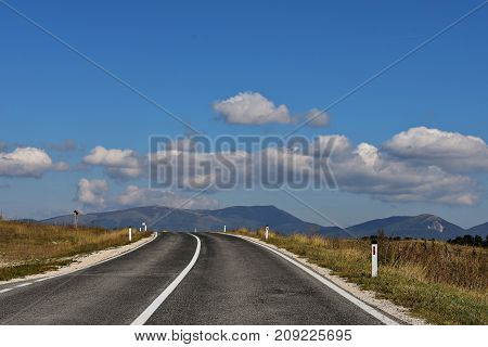An open road through beautiful countryside, landscape travel photography