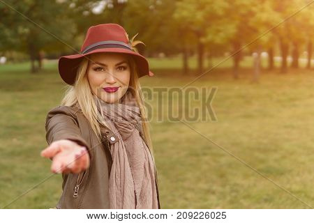 Beautiful Blonde Girl Walking In The Park