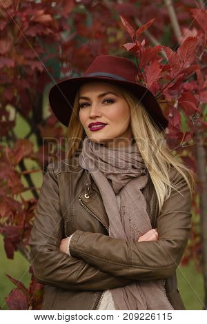 Beautiful Blonde Girl Walking In The Park
