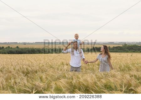 Happy Childhood, Family Together On Wheat Field