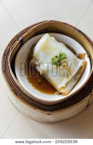 Chinese dim sum in wooden basket