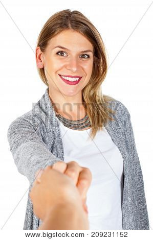 Attractive young woman holding her boyfriend's hand smiling at the camera on isolated background