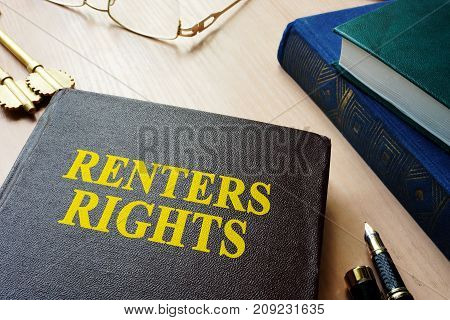 Book with title renters rights and keys.