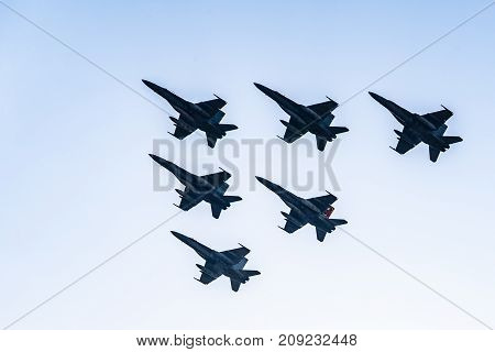 Madrid, Spain - October 12, 2017: Six F18 Hornet jet fighters flying in formation a blue sky day in Spanish National Day Army Parade.
