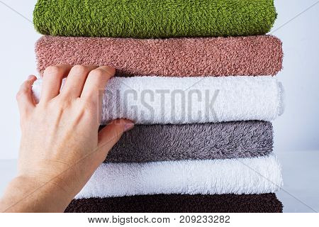 Female Hand Take Stack Bath Towels Colorful Cotton