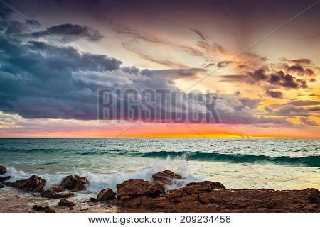 Dramatic sunset with stormy clouds over beach South Australia