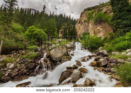 Mountain river in the forest. Cascades and waterfall in the mountains.