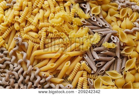 noodles pasta of different kinds scattered on the table.