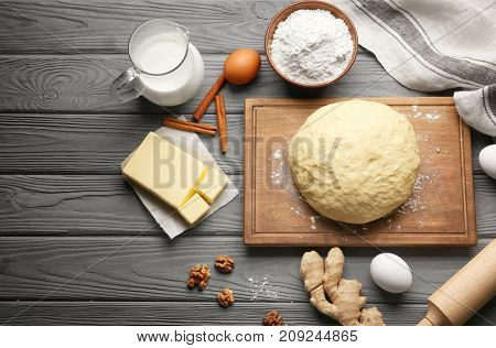Raw dough and ingredients on kitchen table