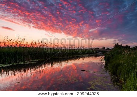 Reflection of a beautiful dawn sky in the river.