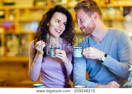 Romantic happy couple having date in coffee shop