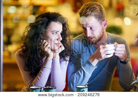Young attractive couple having problems on date and relationship