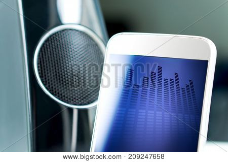 Music streaming with modern portable and wireless smart speaker. Mobile sound application on smartphone screen.