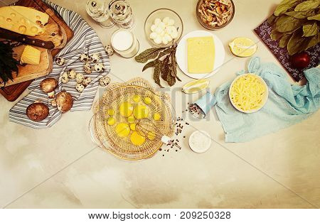 Overhead Of Ingredients Frittata Quiche Vegeterian Diet Meal. Eggs In Bowl, Quail Eggs, Milk, Cheese