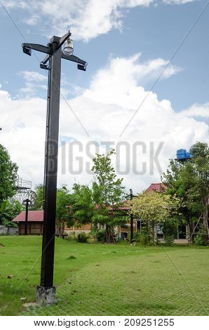 Black Street lamp installed walkway cement grass Front Home
