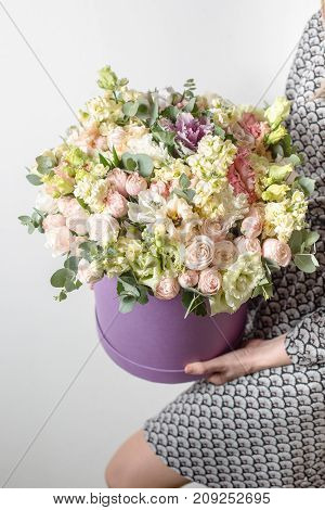 Luxury bouquets of mix flowers in the hat box. copy space