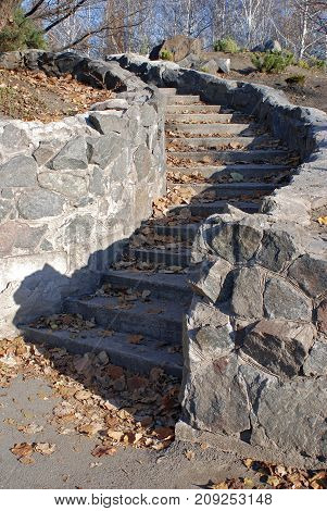 A bright day walked in the park with a Nikon camera. The bright sun on the steps painted a beautiful shadow. Stone steps are like a fairytale road this amazing play of light and shadow attracted my attention and in combination with a blue sky looks very b