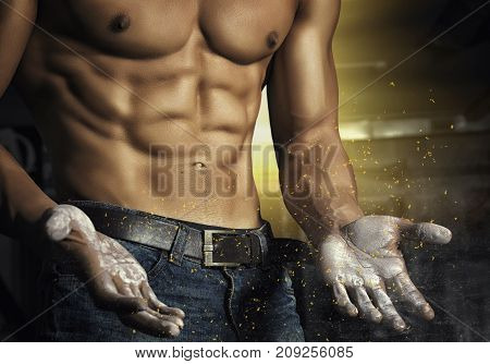 Closeup portrait of a sexy muscular man. Brutal bodybuilder athletic man with six pack, perfect abs, shoulders, biceps, triceps and chest. Stylized photo