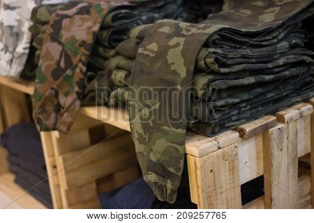 Bundeswehr field flecktarn pants on Stacked on a wooden crate