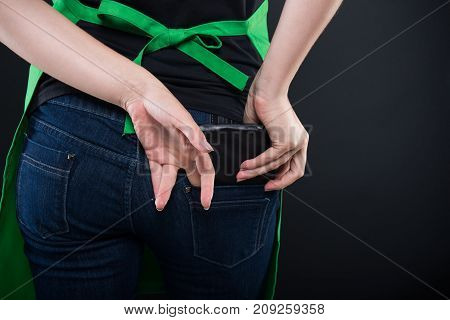 Back View Of Woman Hand Taking Wallet