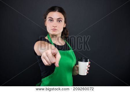 Serious Female Clerk With Coffee